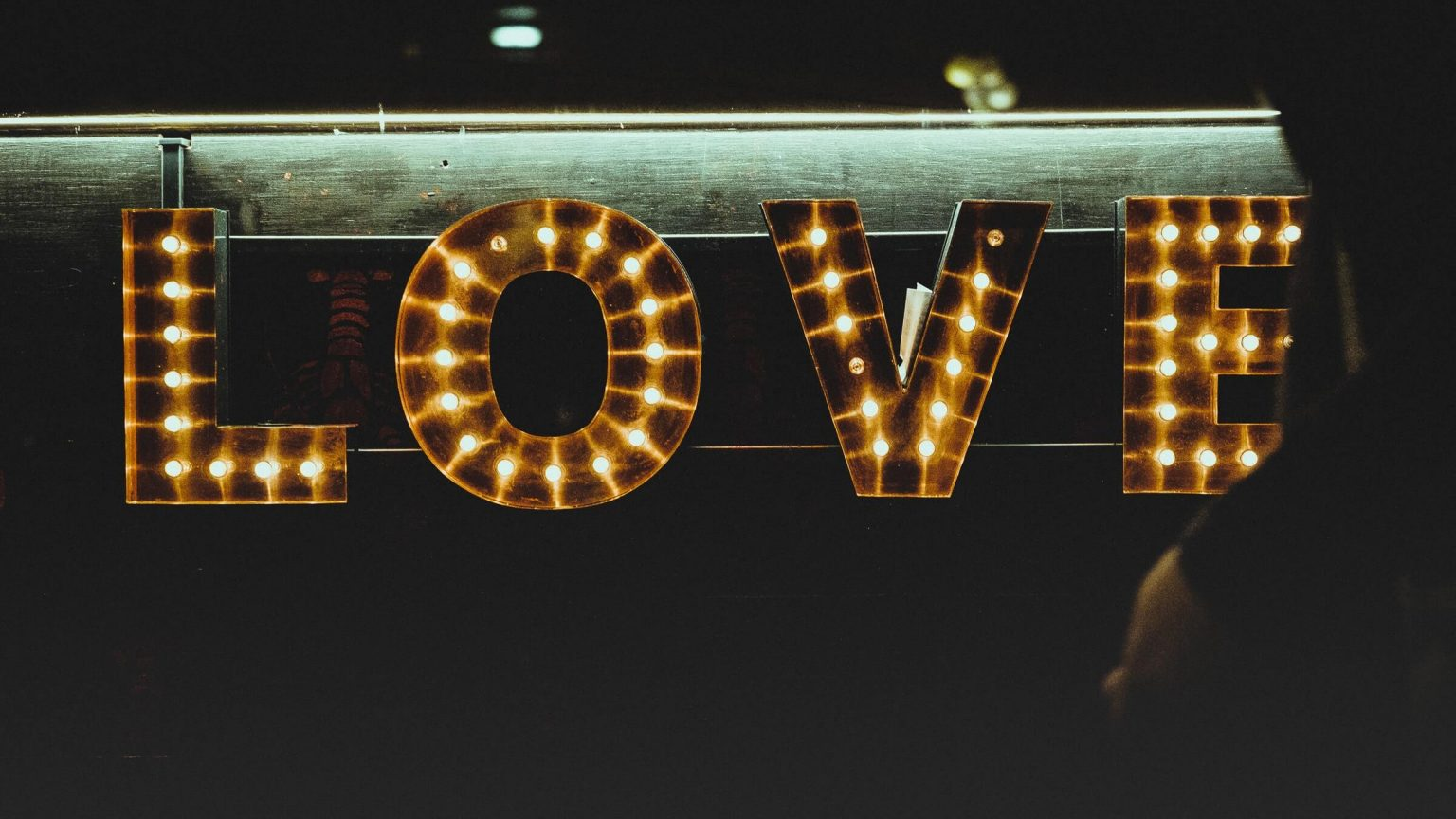 The word Love displayed by light