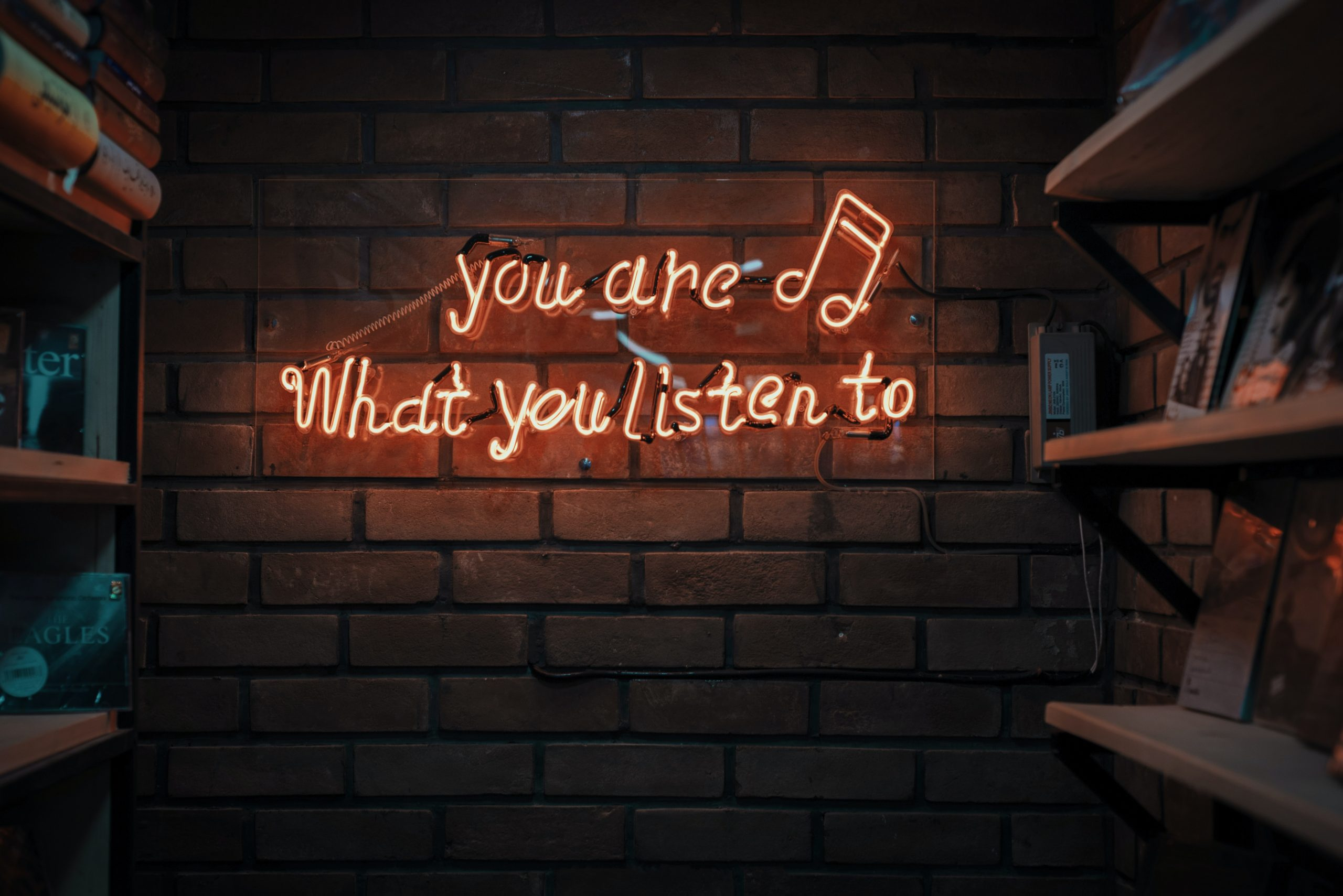 """words on a board that say """" you are what you listen to"""""""